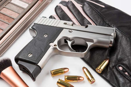 Automatic hand gun and ammunition on white background Фото со стока