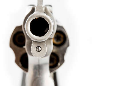 Close up of barrel revolver gun on white background , Concealed pistol Stock Photo