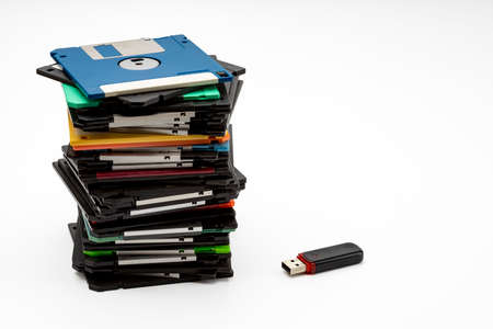 "Stack of 3.5"" Floppy disk and memory flash drive on white background , Retro digital storage technology"