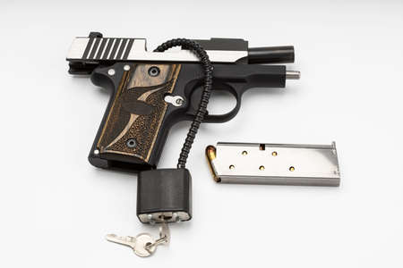 Locked disarmed and secured automatic gun on white background , Gun safety concept