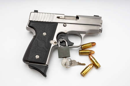 Locked disarmed and secured automatic gun on white background , Gun safety concept Stockfoto