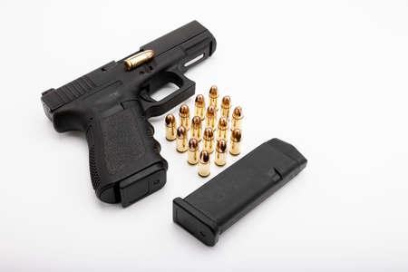 15 rounds bullets magazine and a semi-automatic pistol handgun , Gun law