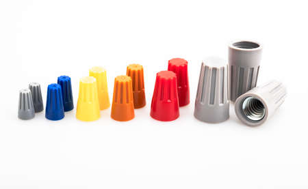 Different sizes and colors of Wire nut connectors on white background , Tool for connecting electrical wires Фото со стока