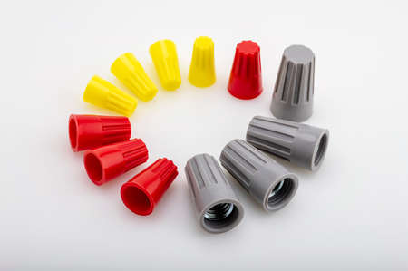 Different sizes and colors of Wire nuts on white background , Tool for connecting electrical wires
