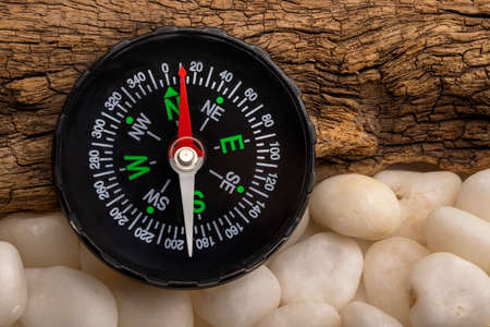 Vintage compass, navigational compass on wooden background Фото со стока