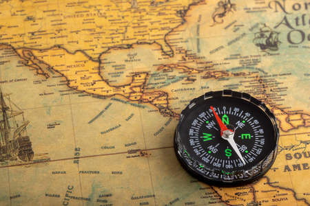 Classic compass on vintage map , Can be used as a background Фото со стока