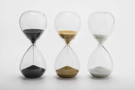 Various sand clock , Various hourglass as time passing on white background , Life time concept