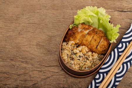 Bento , Japanese style famous lunch box on wooden background Фото со стока