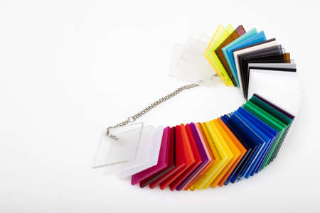 Colorful acrylic sheets plastic samples on white background , equipment for creativity and decoration