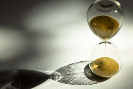 Sand clock , Hourglass as time passing on white background , Life time passed concept