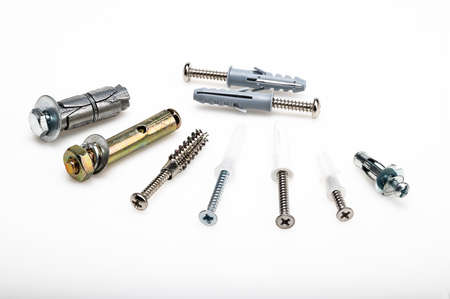 Difference type of steel anchor bolts on white background , Equipment for construction