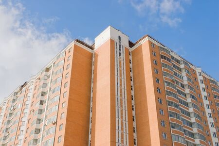 High-rise apartment building on a background of blue sky Stock Photo - 4887428