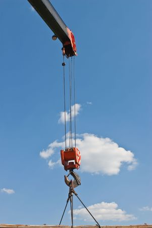 Hook crane, slings and cargo on a cloudy sky photo