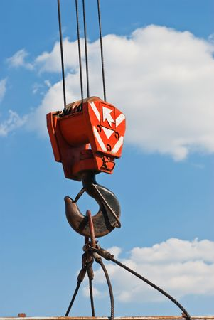 slings: Hook crane, slings and cargo on a cloudy sky