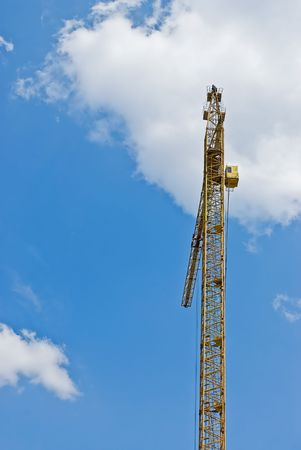 Building tower crane on background of blue sky photo