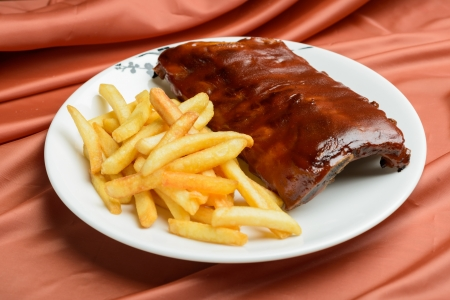 grilled ribs and fried potatoes photo