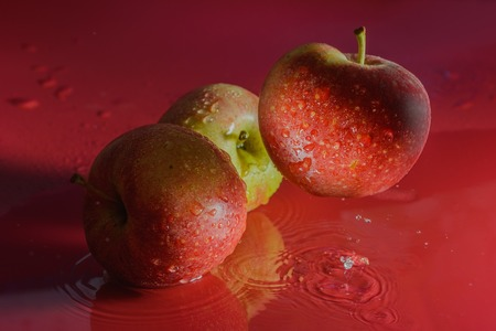 sputter: ripe apples are washed with water