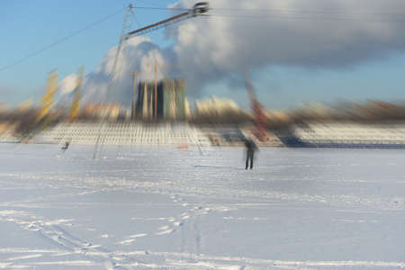 The blurriness of the background in motion on the ice of a frozen pond. Wakeboard - winter active sport.