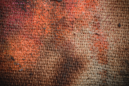 Abstract background. Damaged by fire on canvas- charred piece of cloth.