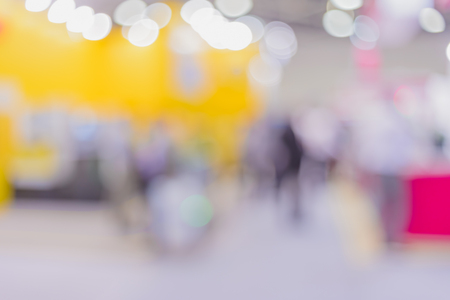 Blurred background- abstract bokeh of light sources. Industrial exhibition- equipment, devices and tools for metalworking industry.