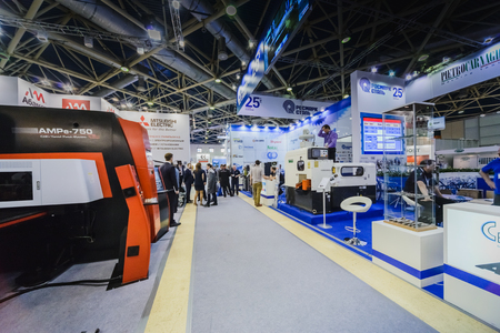 MOSCOW, RUSSIA, Expocentre - MAY 15-19, 2017: 18th international specialized exhibition Equipment, instruments and tools for Metalworking industry. People conduct business meetings at booths product