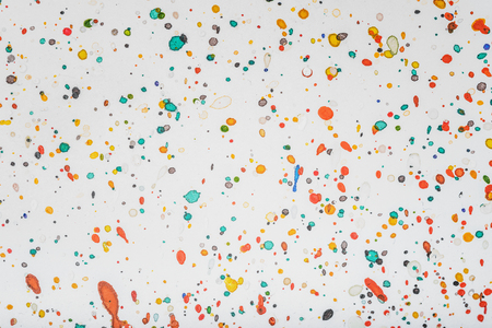 ink stain: Splashes of color drops of paint on gray paper background Stock Photo