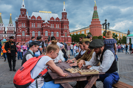 historical events: MOSCOW, RUSSIA - June 1-12, 2017: International festival Times and epochs. The meeting. The game of chess. Military in the form of 40-ies and people in modern clothes.