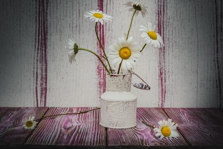 antique vase: Vintage vase metal- still life daisies. Art style chamomile- blooming flowers wonderful decoration of interior.
