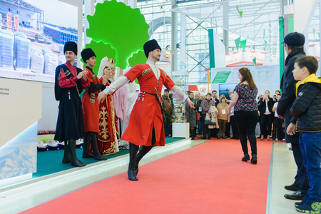 Moscow, Russia, Expocenter VDNH - OCTOBER 4-7, 2017: Russian agro-industrial exhibition Golden autumn. Business stand Kabardino-Balkar Republic. Dance Lezgin entertainment of visitors to the show