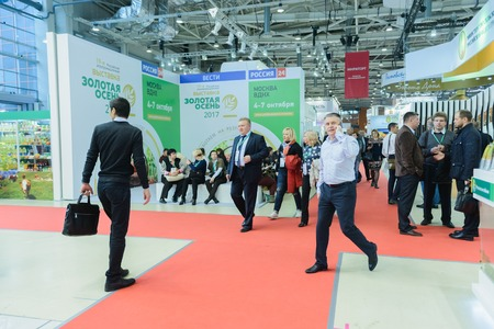 Moscow, Russia, Expocenter VDNH - OCTOBER 4-7, 2017: Russian agro-industrial exhibition Golden autumn. Business stand manufacturers agricultural products- high activity of the visitors trade show