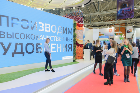 Moscow, Russia, Expocenter VDNH - OCTOBER 4-7, 2017: Russian agro-industrial exhibition Golden autumn. Business stand manufacturer of mineral fertilizers. Photo on the background advertising screen