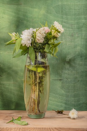 Still Life Painting Beautiful Flowers In A Vase Wooden Background