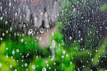 Background wet- raindrop realistic. Water splash shower- bad weather. Window- soap foam. Rainwater- liquid splash abstract