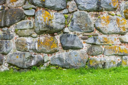 Brick stone wall- architecture pattern. Medieval fortress- background nature