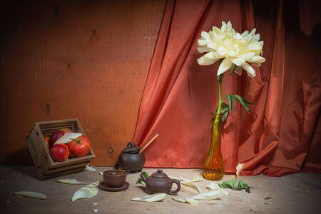 Still life of peonies. Spring- blossom season. Background- cloth drapery. Fine art- decoration concept