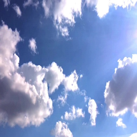 timelapse: White clouds disappear in the hot sun on blue sky. Time-lapse motion clouds blue sky background.