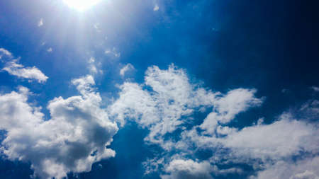 beautiful blue sky with clouds background.Sky clouds.Sky with clouds weather nature cloud blue.Blue sky with clouds and sun. Stock Photo