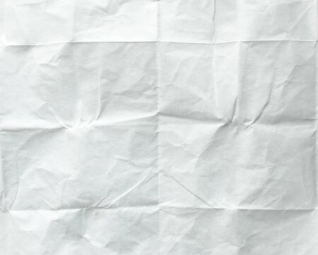 ice sheet: White sheet of paper folded. Crushed and folded white sheet of paper. Note paper. Wrinkled paper.