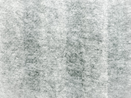Gray heather fabric texture. Real heather grey knitted fabric made of synthetic fibres textured background