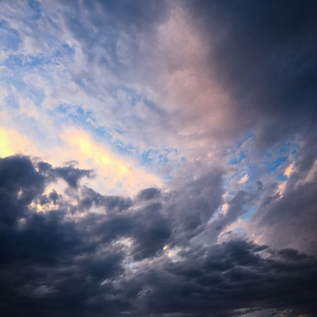 Beautiful stormy sky with clouds background. Dark sky with clouds weather nature cloud storm. Dark sky with clouds and sun Archivio Fotografico