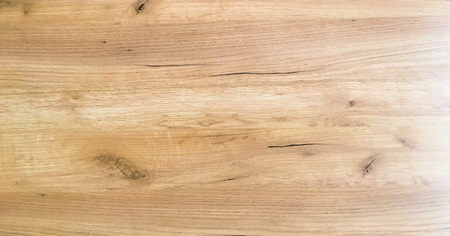 Light soft wood surface as background, wood texture. Grunge washed wood planks table pattern top view