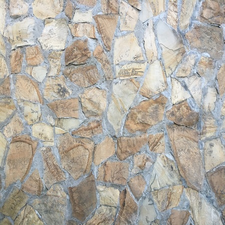 Stone block road pavement as texture. Background wall or floor with paving stones. Rock tile wallpaper Stock Photo