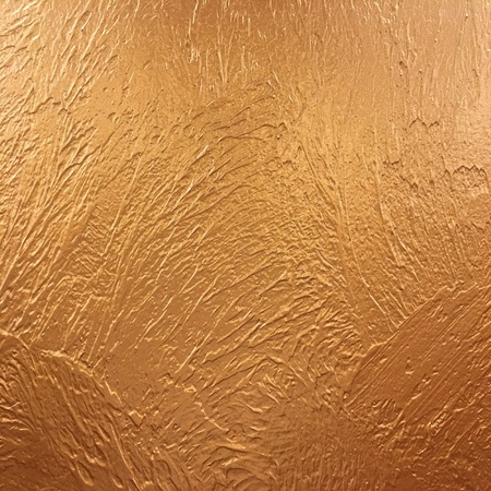 gold background paper, texture is old vintage distressed solid glitter gold color with rough peeling grunge paint on edges Stock Photo