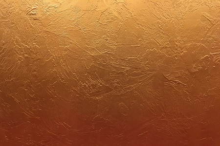 Gold background or texture and gradients shadow. Shiny yellow leaf gold foil texture background