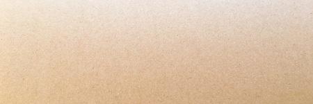 Paper texture - brown kraft sheet background. Textured paper surface