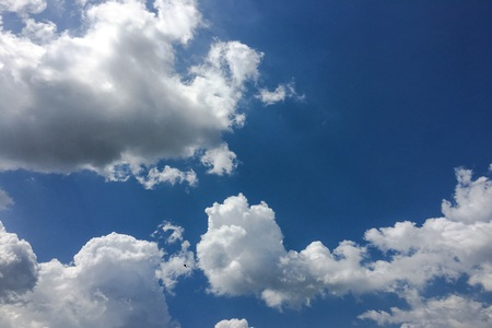 Beautiful clouds against a blue sky background. Cloud sky. Blue sky with cloudy weather, nature cloud. White clouds, blue sky and sun