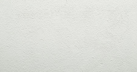 Grungy painted wall texture as background. Cracked concrete vintage wall background, old white painted wall texture. Background washed painting Stock Photo
