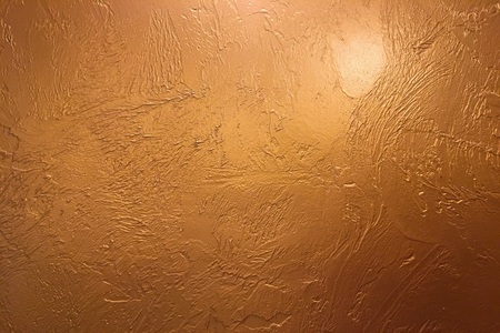 Gold background or texture and gradients shadow. Shiny yellow leaf gold foil texture background. Gold background paper, texture is old vintage distressed solid glitter gold color with rough peeling grunge paint on edges