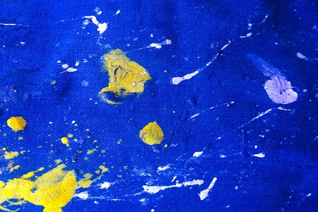 Texture of denim or colorful paint on blue jeans background. Drops of color paint on blue background of denim, jeans Reklamní fotografie