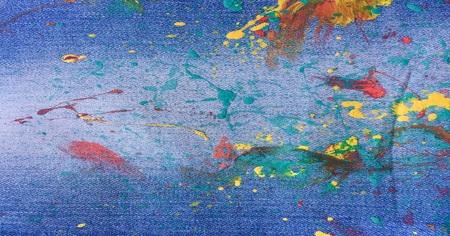 Denim, jeans texture background. Drops of colorful paint on blue background denim, jeans Archivio Fotografico